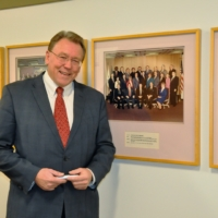 Don Brown in Macomb County Hallway with Picture of Board of Commissioners