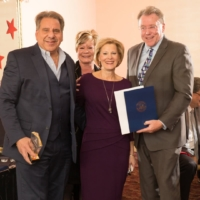 Don Brown gives award at Romeo Washington Chamber of Commerce Emmas